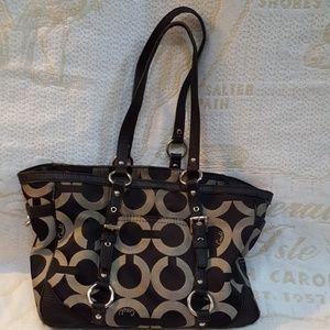 Signature COACH black handbag with purple interior